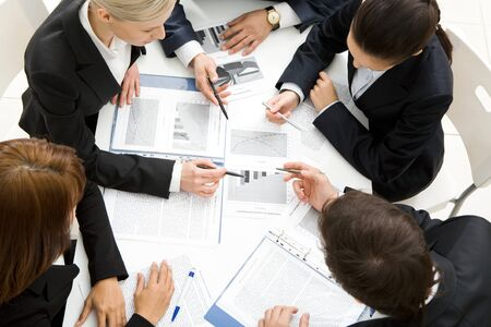 workteam: Above view of successful workteam discussing new plan at meeting Stock Photo