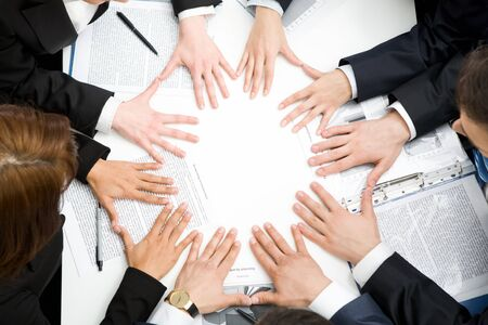 next to each other: Image of business people keeping their hands next to each other in the form of circle