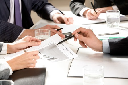 Photo of people hands during teamwork at meeting on table working with papers Stock Photo - 4554782