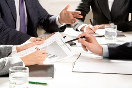 Close-up of business people hands with pens during explanation at meeting Stock Photo - 4554784