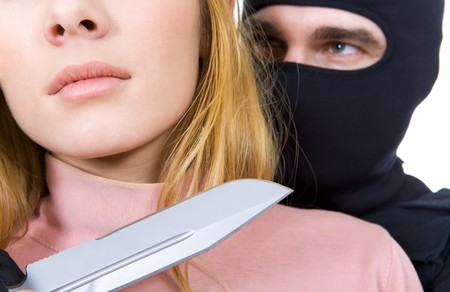 balaclava: Close-up of female neck with big sharp knife in killer's hand near by Stock Photo