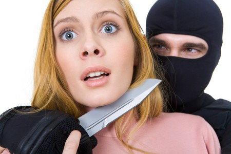 Image of pretty woman horrified trying to set herself free from criminal hands holding dangerous knife photo