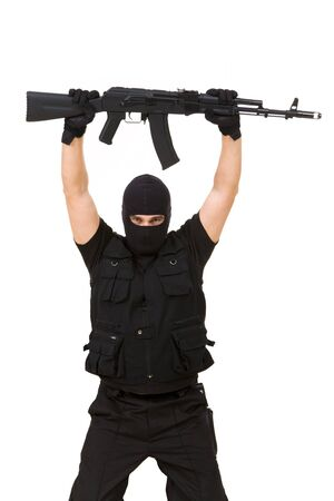 Portrait of armed assassin raising rifle in his hands over white background Stock Photo - 4544772