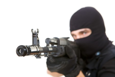 balaclava: Image of killer pointing his gun at camera with focus on its muzzle