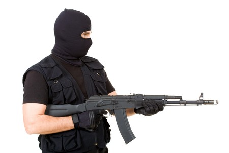 Profile view of cruel gangster with pointed rifle isolated over white background Stock Photo - 4544791