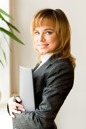 Portrait of successful businesswoman looking at camera and smiling Stock Photo - 4544955