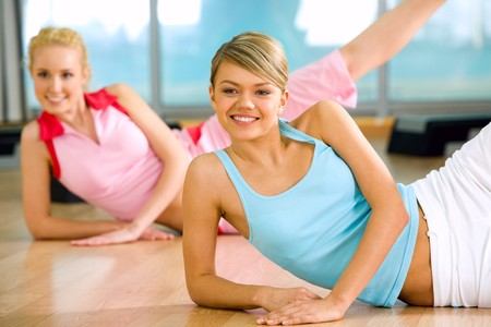 Image of sporty girl doing physical exercise with the other female at background Stock Photo - 4549468