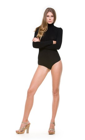 Portrait of elegant woman in black leotard standing on high-heeled shoes  photo