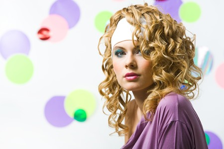 Portrait of glamorous blonde with wavy hair-style looking at camera on colorful background Stock Photo - 4554969