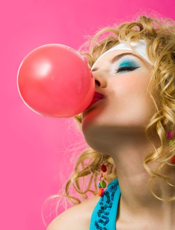Image of sexy girl blowing big red bubble with her eyes shut