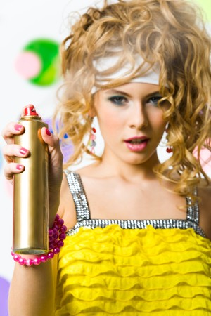 to lacquer: Photo of hair lacquer in hand of glamorous lady spraying it before you Stock Photo
