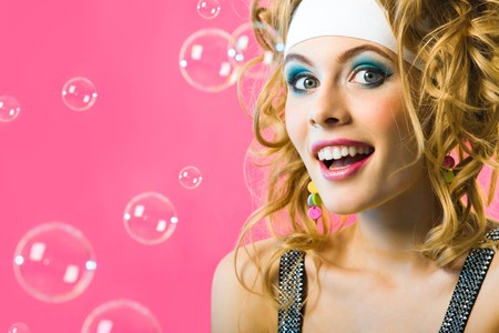 Photo of happy girl surrounded by soap bubbles on pink background Stock Photo - 4554990