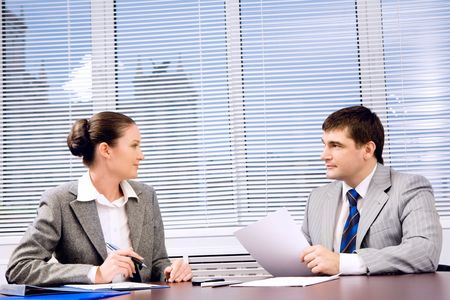 Photo of confident business partners looking at each other during formal communication Stock Photo - 4624738
