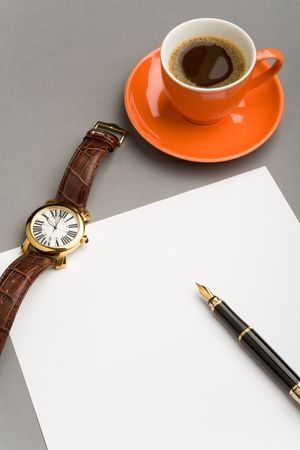 Image of blank paper sheet with fountain pen, watch and red cup of coffee on workplace photo