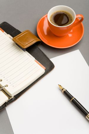 Image of blank paper sheet with fountain pen and red cup of coffee near by Stock Photo - 4623378