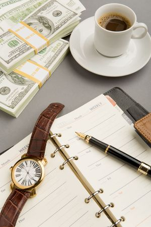 Image of open notepad with fountain pen and watch on it with cup of coffee and dollar banknotes near by Stock Photo - 4624746