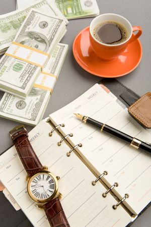 Image of open notepad with fountain pen and watch on it and red cup of coffee with dollar banknotes near by Stock Photo - 4623448
