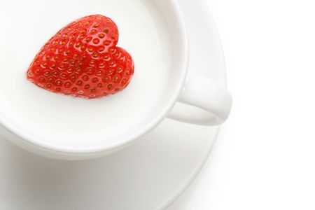 fruitage: Macro image of heart-shaped strawberry in milk shake
