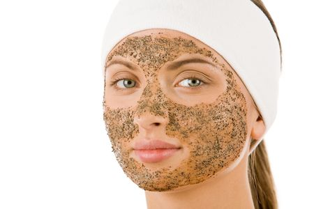 Beautiful woman with cleansing mask on her face looking at camera photo