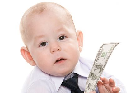 Portrait of serious baby boy with dollar banknote looking at camera photo