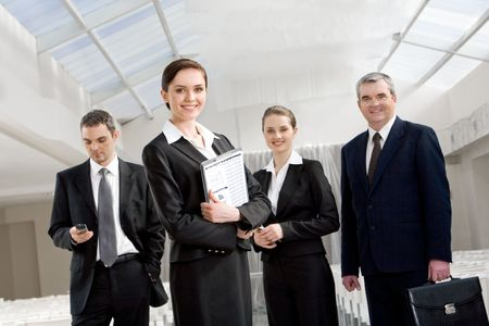 Portrait of smart business people looking at camera and smiling Stock Photo - 4642300
