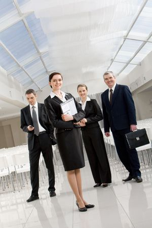 Portrait of successful business partners standing in conference hall and looking at camera Stock Photo - 4642332