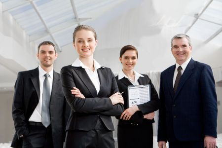 Portrait of smart businesswoman looking at camera at background of co-workers Stock Photo - 4642331