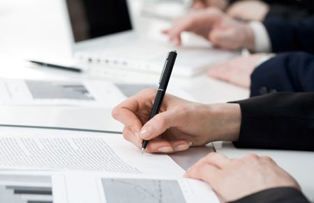 Image of human hand writing on paper at seminar or conference Stock Photo - 4646986