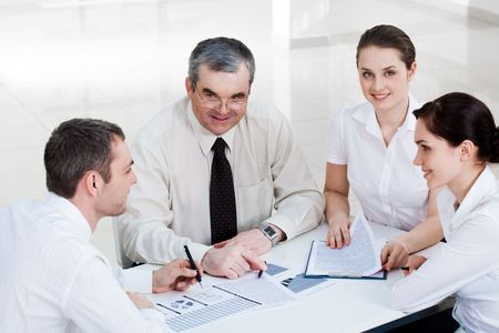 Photo of confident co-workers planning new project at briefing Stock Photo - 4642323