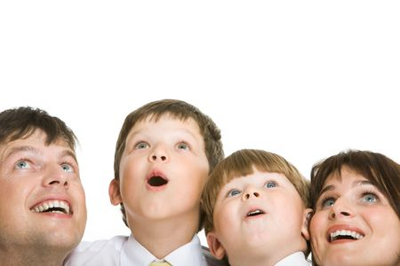 surprised child: Photo of surprised family members looking upwards with excitement