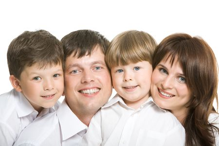 Happy couple and their two sons looking at camera face to face Stock Photo - 4642392