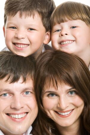 Photo of attractive father and mother with two siblings above them looking at camera Stock Photo - 4642393