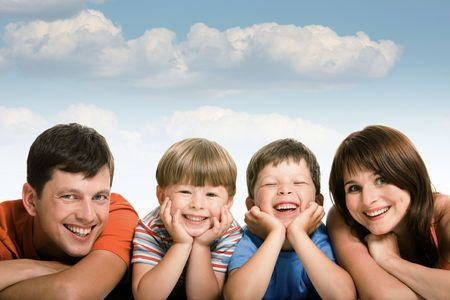 Line of happy family members looking at camera and smiling over white background Stock Photo - 4642394