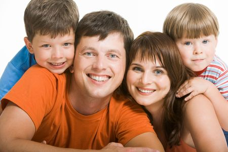 Portrait of joyful family laughing and looking at camera on white background Stock Photo - 4642338