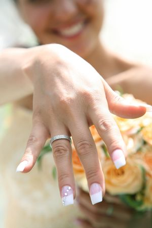 Close-up of bride's hand with posh wedding ring showing it to you Stock Photo