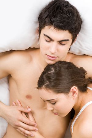 Photo of loving woman putting her head on male's chest while both sleeping Stock Photo