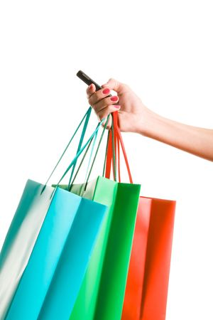 Image of female hand holding colorful shopping bags and phone Stock Photo - 4647003