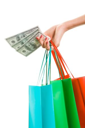 shopping spree: Photo of hand with dollars carrying bags
