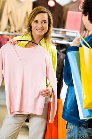 Portrait of pretty woman with new tanktop asking her boyfriend for advice Stock Photo - 4647019