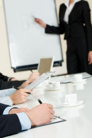 Image of human hands making notes on paper at seminar or conference Stock Photo - 4681759