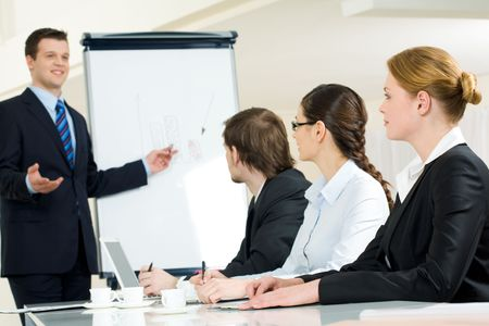 Photo of successful businessman sharing ideas by whiteboard with partners at presentation Stock Photo - 4681042