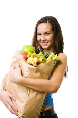 Portrait of pretty girl with big paper sack full of different fruits and vegetables looking at camera with smile photo