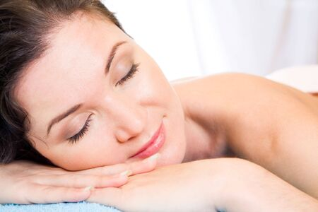 eyes shut: Beautiful woman with her eyes shut having rest in the spa salon