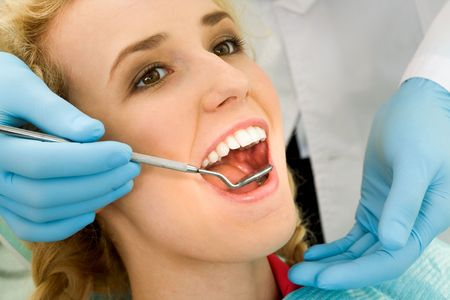 Close-up of young woman during inspection of oral cavity with help of hook and mirror Stock Photo - 4843159