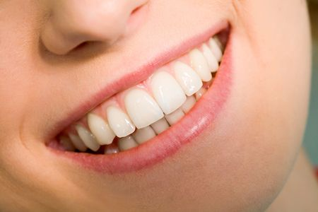 dental treatment: Close-up of happy female smile and healthy teeth