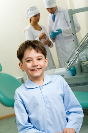 Portrait of happy boy in dentist room on background of two doctors Stock Photo - 4843186