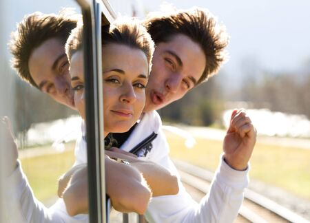 Photo of romantic couple looking out of train window and having fun Stock Photo - 4843184