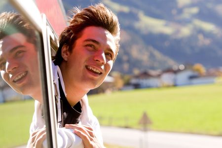 Photo of cheerful passenger looking out of train window while moving fast Stock Photo