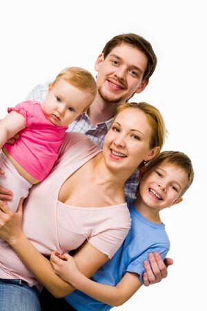 Portrait of happy couple with their son and small daughter over white background Stock Photo - 4920802