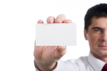 Portrait of confident businessman showing blank visiting card in his hand photo
